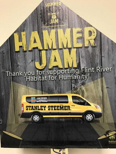 Stanley Steemer Flint River Habitat for Humanity Hammer Jam Sponsorship sign