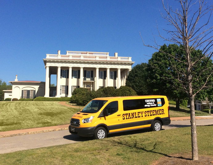 Stanley steemer carpet cleaning van in front of house in macon georgia