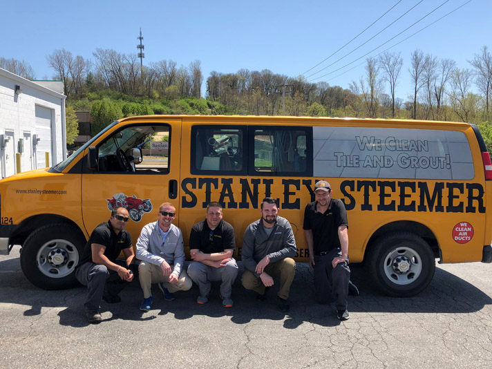 Stanley Steemer team in front of Tile and Grout van in Maryland Heights Missouri