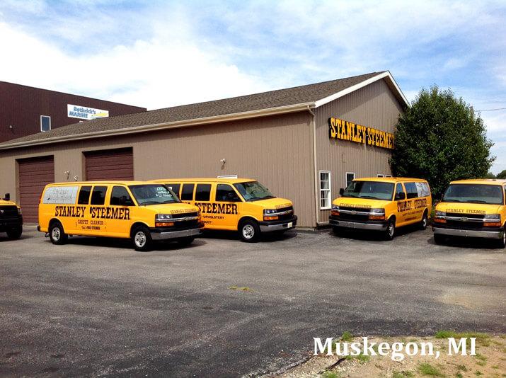 Stanley Steemer vans in front of Stanley Steemer business location in Muskegon Michigan