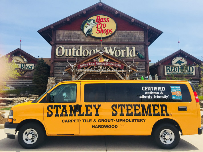 Stanley Steemer van of Peoria, Illinois parked in front of Bass Pro Shop, ready to clean carpet, hardwoods, upholstery, and more.
