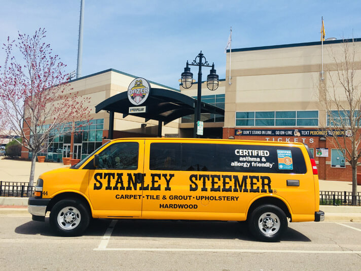 Carpet cleaning van parked outside of Dozer Park in Peoria, Illinois.