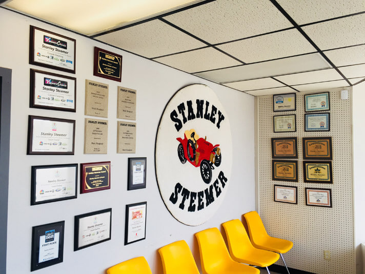 Inside of lobby at Stanley Steemer of Peoria Illinois with carpet cleaning service awards.