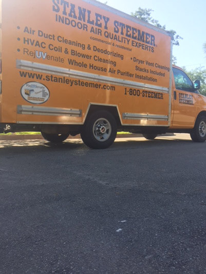 Stanley Steemer air duct cleaning service van parked in Port Saint Lucie, Florida.