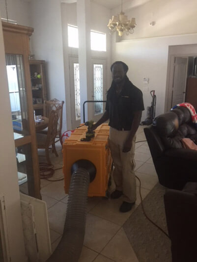 Air Duct cleaning with a smile inside of a home in Port Saint Lucie, Florida.