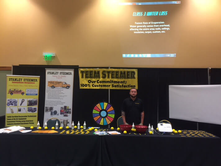 Stanley Steemer of Port Saint Lucie, Florida explain their cleaning services at the Hurricane Expo.