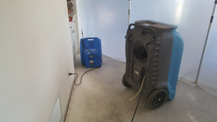 Water Restoration equipment set up in a home in Port Saint Lucie, Florida.