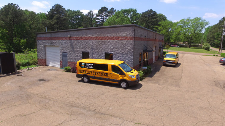 Stanley Steemer carpet cleaning vans parked out front of the office in Ridgeland, Mississippi.