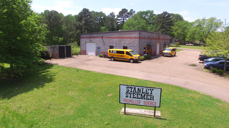 Stanley Steemer Propeller Service sign with service vans in Ridgeland, Mississippi.