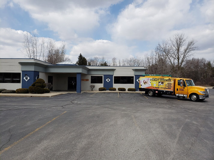 Carpet, air duct, and tile cleaning service truck parked at the office in Saginaw, Michigan.