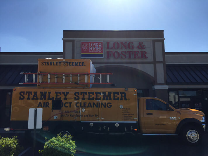 Stanley Steemer air duct cleaning truck parked at a store front in Salisbury, Maryland.