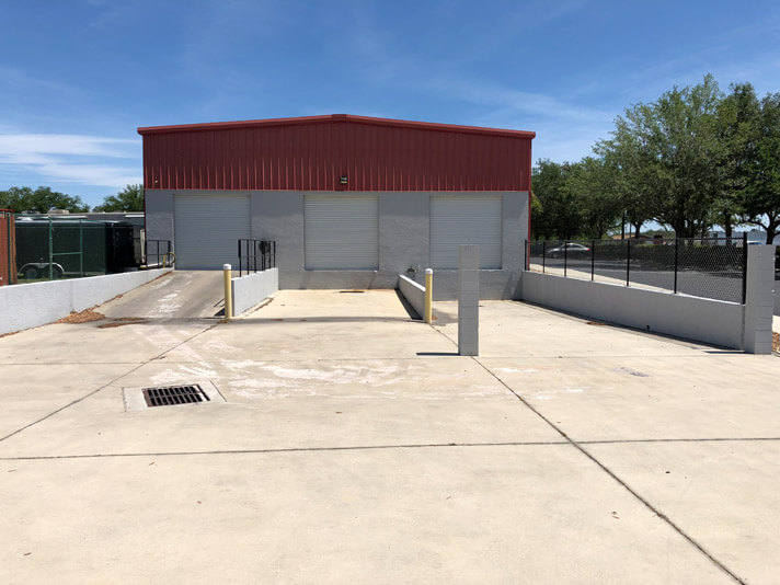 Loading dock for carpet, air duct, and tile cleaning trucks in Sebring, Florida.