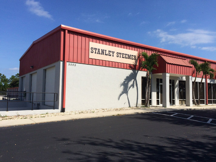 Carpet cleaning truck service bays and front of office in Sebring, Florida.