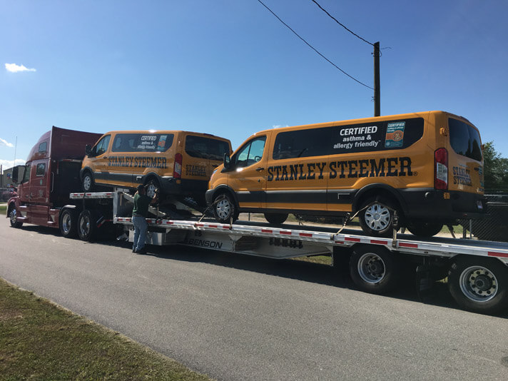 Brand new vans for carpet, tile, hardwood, and air duct services delivered to Sebring, Florida.