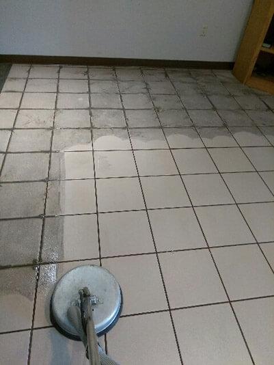 Tile cleaning service exposing clean tile in Springdale, Arizona.