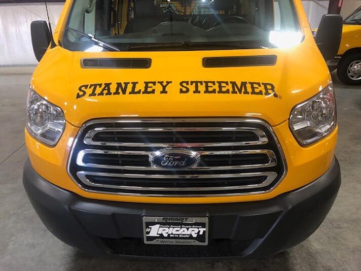 Front end of Stanley Steemer van parked in Springdale, Arizona.