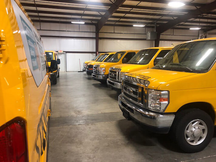 Fleet of carpet/tile/grout/air duct cleaning service vans parked in the Springdale, Arizona office location.