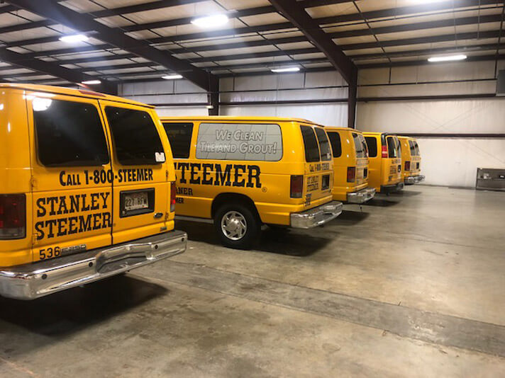 Stanley Steemer vans parked side by side at the Springdale, Arizona location.