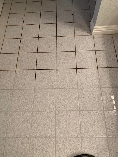 Stanley Steemer wand cleaning light colored tile and grout