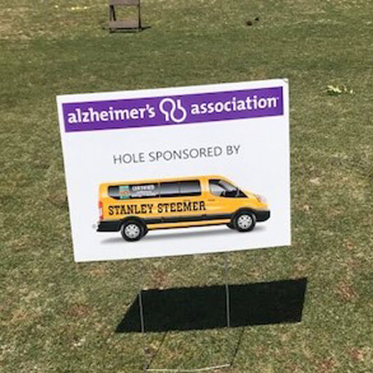 Alzheimer's Association sign stuck in the ground showing that the Valdosta, Georgia office sponsored them.