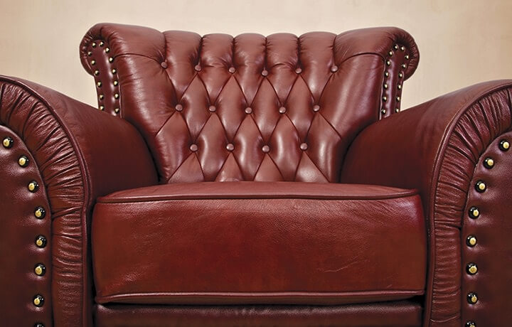 Brown leather chair with studs.