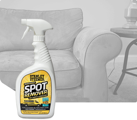 Bottle of Stanley Steemer spot remover for carpet and upholstery.