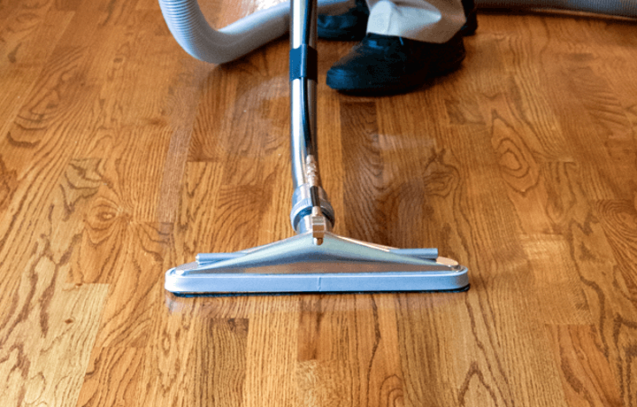 Hardwood floor cleaning machine being used by technician