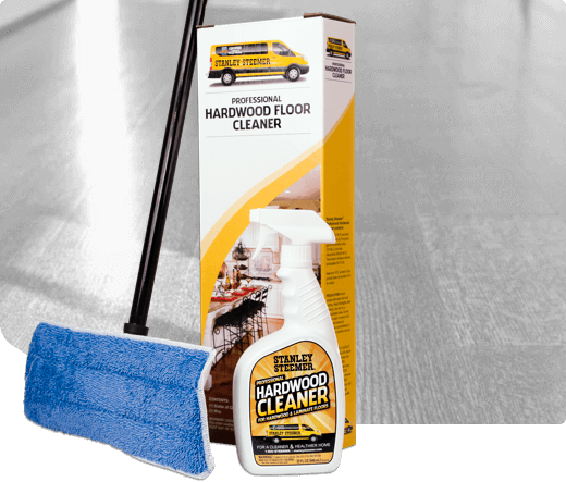 Stanley Steemer hardwood floor cleaning maintenance kit with hardwood cleaner spray and mop.