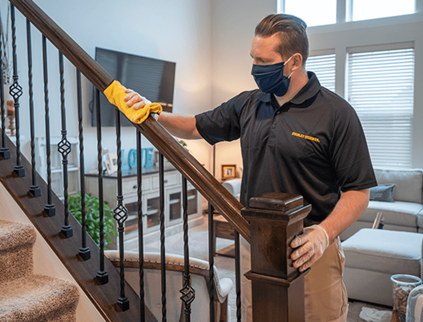 Technician disinfecting surface