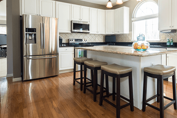 Hardwood floored kitchen with a large island and open concept
