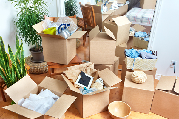 Moving boxes scattered in home