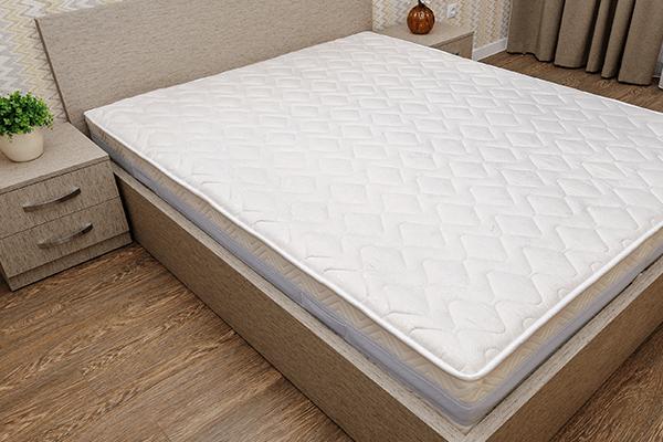 Plain mattress on a bedframe