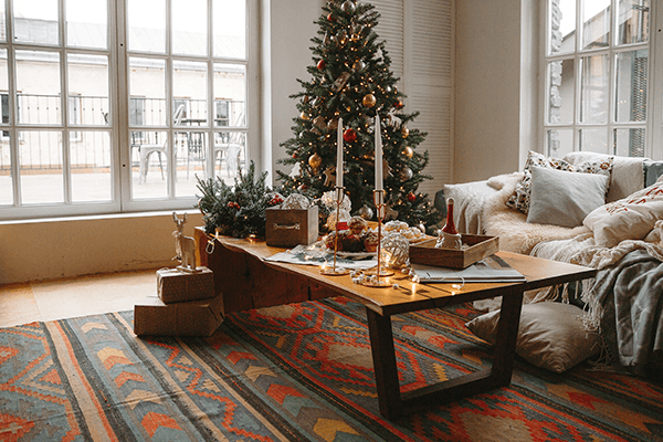 Festive living room showing a Christmas tree and couch