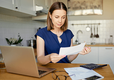 Woman looking over carpet cleaning prices and offers