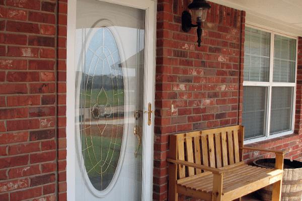Storm door placed before the front door of home