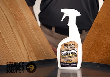 Bottle of Stanley Steemer hardwood floor cleaner spray.