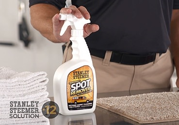 Bottle of Stanley Steemer spot remover.