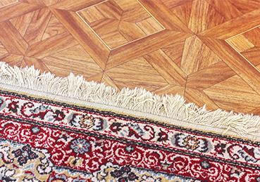 Oriental rug overtop hardwood floor